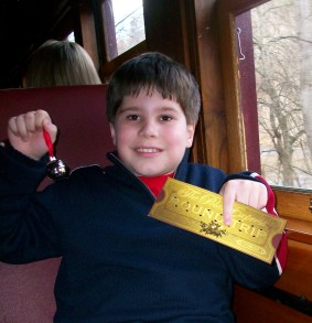 My Son with his Silver Jingle Bell and Roundtrip Ticket on The Polar Express, Great Smoky Mountains Railroad, Bryson City, North Carolina, December 2012