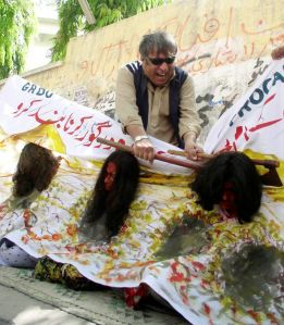 Pakistani Activists Performing Honor Killing Skit to Protest 2008 Honor Killings of Women (Retrieved on May 31, 2014 from http://www.rcinet.ca/english/archives/column/the-link-s-top-stories/pakistani-family-fears-honour-killing/)
